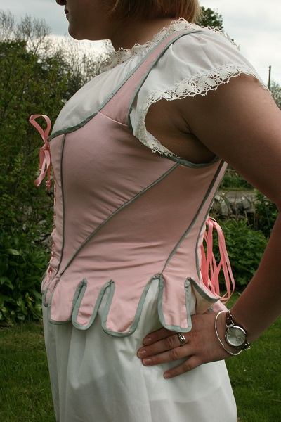 my 1790 period corset made as historically correct as possible.  All eyelets were hand stitched, boned and piped seams all hand finished.